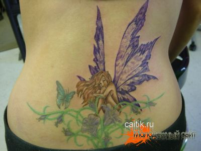 женская татуировка фея на пояснице