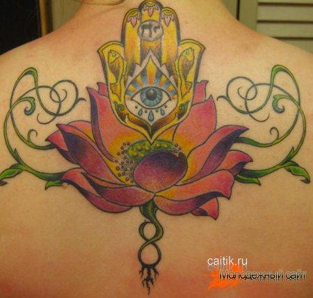 татуировка на спине лотос с глазом