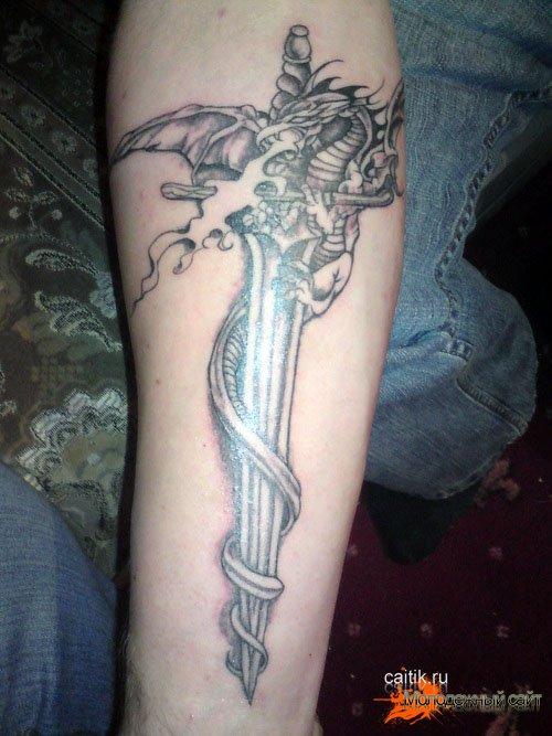 татуировка меч