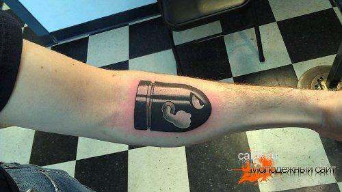татуировка пуля на руке