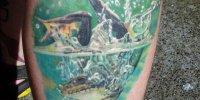 татуировка лягушка в воде