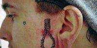татуировка петля на виске