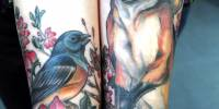 татуировки на ноге лиса и птица