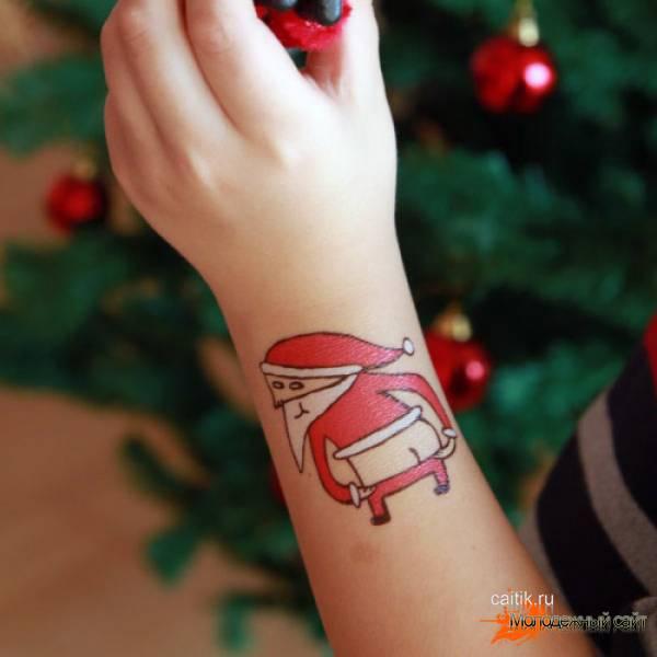 татуировка санта на руке