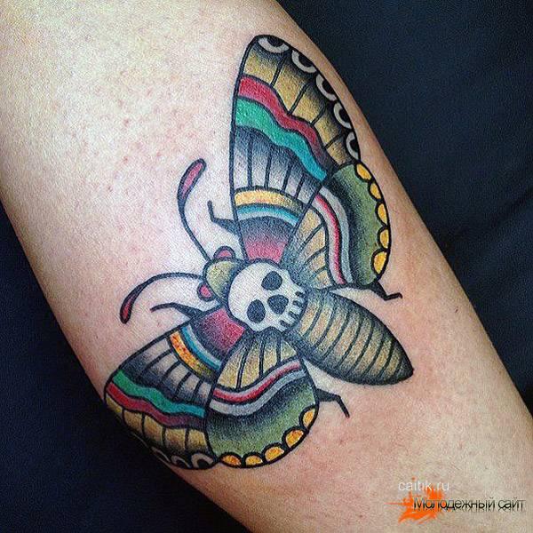 бабочка в радужном цвете