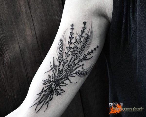 связанные колоски пшеницы татуировка на руке